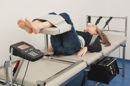 Photo for Spinal rehabilitation exercise on young woman. Spinal Decompression Therapy - Royalty Free Image