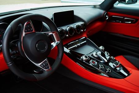 Photo pour Luxury car Interior. Steering wheel and dashboard - image libre de droit