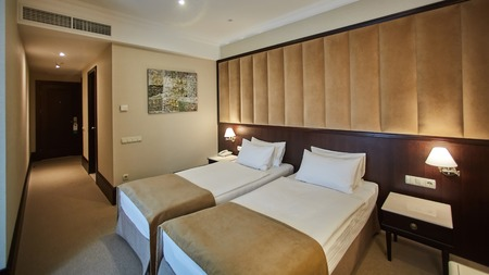 Photo for Two beds in a hotel room. Interior design - Royalty Free Image