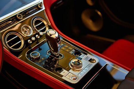 Photo pour Automatic gear shift handle. Red luxury car Interior. Shallow doff. - image libre de droit