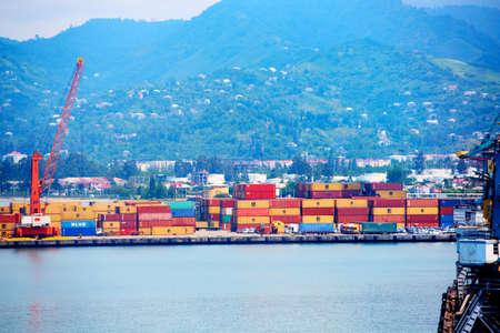 Photo for Batumi, Georgia - June 09, 2015: Batumi International Container Terminal. Cargo port in Batumi, Georgia. Cargo port with blue sea and blue sky, ships, trains cranes, containers - Royalty Free Image