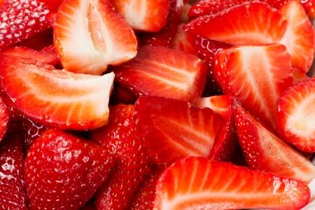 Closeup of many fresh chopped strawberries