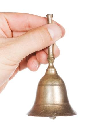 Foto für Hand with an old golden bell over a white background - Lizenzfreies Bild
