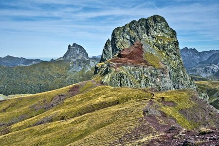 Peak Anayet 2575 m in Spanish Aragon and peak Midi d Ossau 2807 m in French Bearn seen from Vertice d Anayet 2559 m in Pyrenees mountains