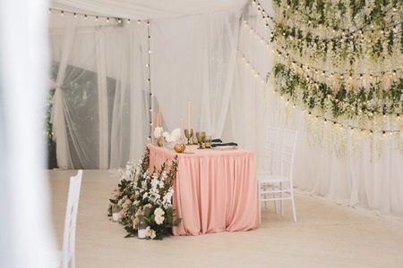 wedding decor, decorated table of the newlyweds, table setting, flowers, green and pink decor, candles