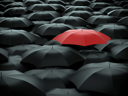Photo pour Red umbrella over many black umbrellas - image libre de droit