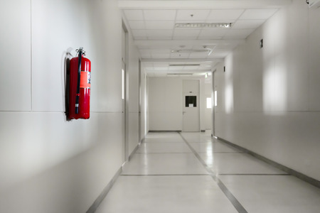 Photo for Fire extinguisher in empty corridor - Royalty Free Image