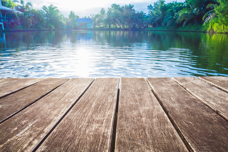 antique wooden pier on the lake with sunlight effects
