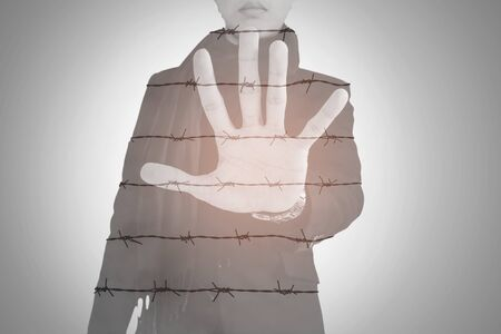 Double exposure, businessman show palm with barbed wire, abstract concept