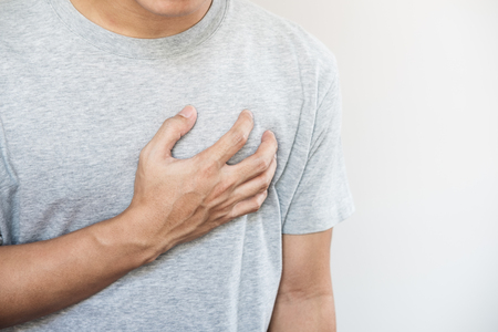 A man touching his heart. Heart attack, heart failure, others heart disease