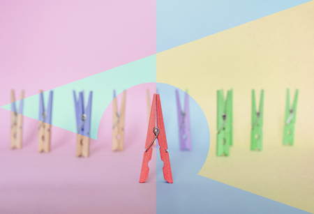 Photo pour Unique, individuality, leadership and think different concept. One wooden clip difference with other clips, with difference geometric shape in vintage pastel colored - image libre de droit