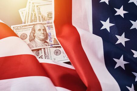 Photo pour USA national flag and currency usd money banknotes. Business and finance concept - image libre de droit