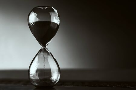 Photo pour Hourglass on dark background with copy space. Concept of running out of time and deadline - image libre de droit