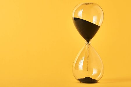 Photo pour Hourglass on yellow background with copy space. Concept of running out of time and deadline - image libre de droit