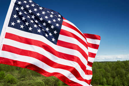 Photo pour Waving american flag outdoors.USA national flag against blue cloudy sky. 4th July Independence Day - image libre de droit
