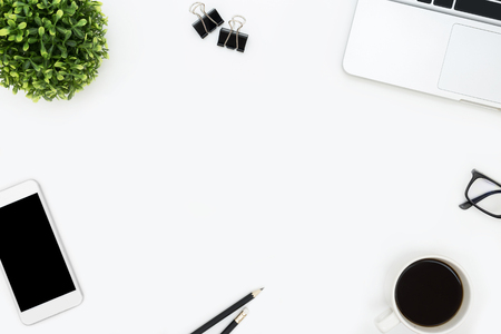 Photo for White office desk table with laptop, smartphone, coffee and supplies. Top view with copy space, flat lay. - Royalty Free Image