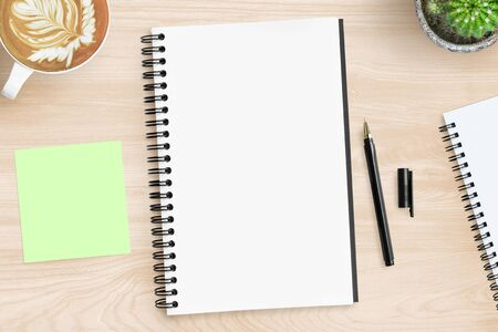 Photo for Blank notebook page is on top of wood office desk table with supplies. Top view, flat lay. - Royalty Free Image