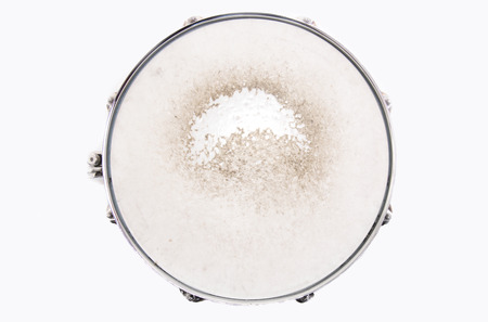 Music conceptual image. Close up of a drum snare on isolated background.