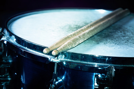 Drums conceptual image. Snare drum and stick.