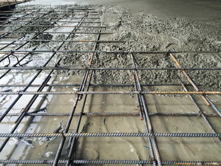 Photo pour Concrete pouring in construction site - image libre de droit