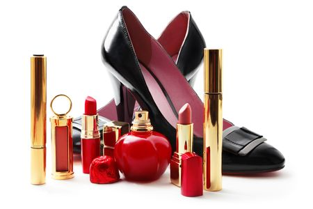 Lady shoes and cosmetics isolated on white