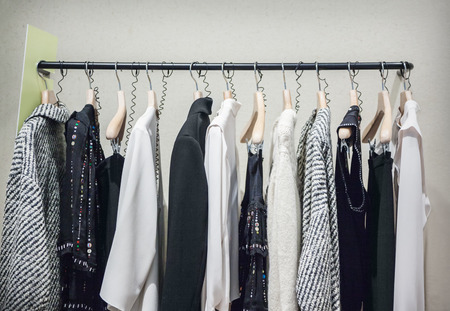 A row of clothes hanging on the rack