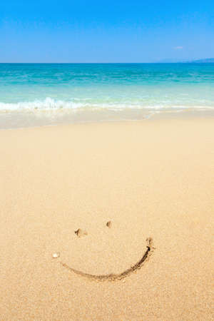 Photo for Smiley drawn in the sand on the beach - Royalty Free Image