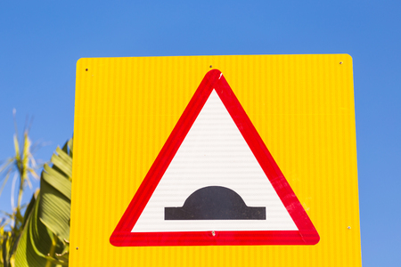 Warning traffic sign. Uneven road.