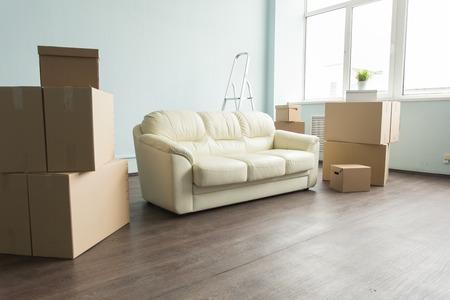 Foto de Empty room full of cardboard boxes for moving into a new home. - Imagen libre de derechos