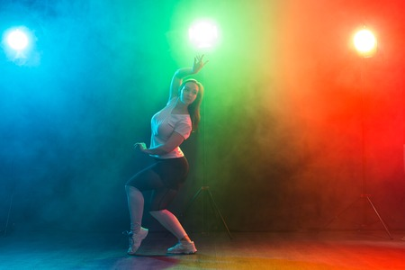 Full-length portrait of slim young woman dancing jazz-funk