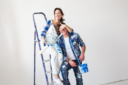 Photo for People, repair and relationship concept - Young funny couple doing renovation in new apartment - Royalty Free Image