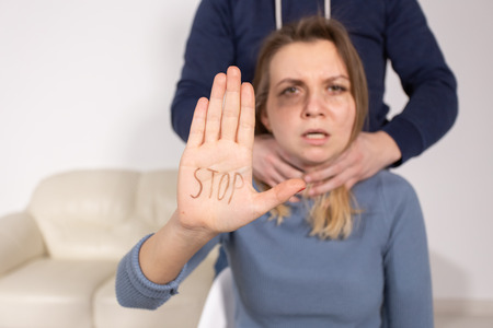 Photo for Alcoholism, abuse and problem concept - Sad woman shows stop sign, stop domestic violence - Royalty Free Image