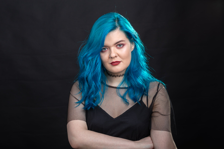 Photo for Sryle and fashion concept - Close up portrait of woman with blue long hair over black background - Royalty Free Image