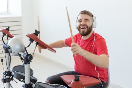 Photo for Music, people and hobby concept - man drummer playing the drum and looks like very emotional - Royalty Free Image