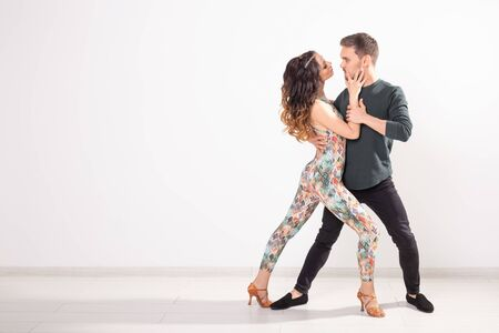 Photo for Social dance, bachata, kizomba, tango, salsa, people concept - Young couple dancing over white background with copy space - Royalty Free Image