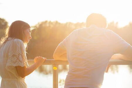 Photo pour Wonderful young couple enjoy life together with natural outdoor leisure activity lifestyle on nature and the sunset in backlight. - image libre de droit