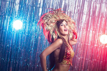 Photo for Carnival, dancer and holiday concept - Beauty brunette woman in cabaret suit and headdress with natural feathers and rhinestones. - Royalty Free Image
