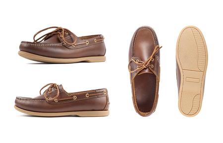 Foto de Men's brown moccasins, loafers isolated white background. Side view, top view and sole - Imagen libre de derechos