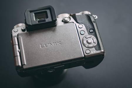 Bishkek, Kyrgyzstan - FEBRUARY, 17, 2018. Back view of camera with logo lumix. Review a mirrorless camera Panasonic Lumix G7