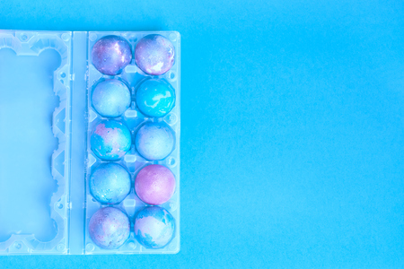 Photo for Painted Easter eggs with space intergalactic pattern in stand on blue background - Royalty Free Image