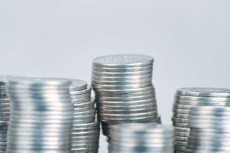 Photo pour Stacks of silver coins on white background. Concept of business planning and finance. Expenses and earnings. Different growth of infographics. Small savings. Alms and donations. - image libre de droit
