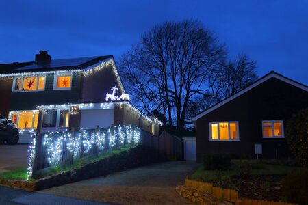 Photo for House decorated with Christmas light in Colyton, Devon - Royalty Free Image