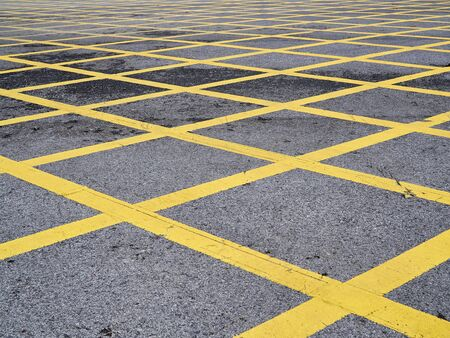 Photo for Do not parking yellow cross sign on road serface - Royalty Free Image