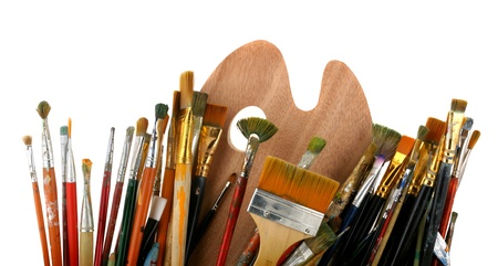 Brushes with a palette isolated on a white background