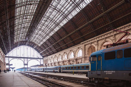 Photo for BUDAPEST, HUNGARY - 25 Juanary 2019: Locomotives and coaches and passengers on the Keleti Railway Station in Budapest, the oldest in Europe. - Royalty Free Image