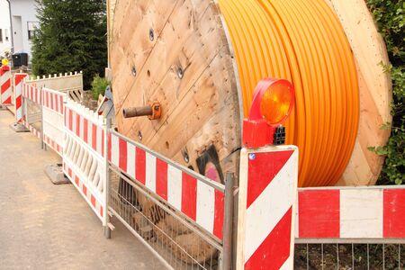 Photo pour Orange fiber optic cable on the street - image libre de droit