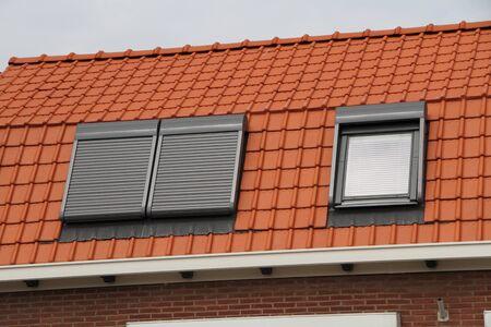 Photo pour A house with new roof windows - image libre de droit