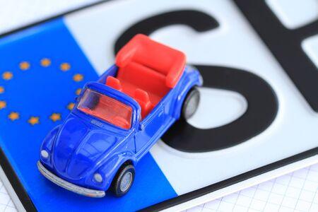 Foto de License plate with a car key - Imagen libre de derechos
