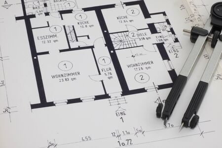 Photo pour A blueprint with pocket calculator and a folder - image libre de droit