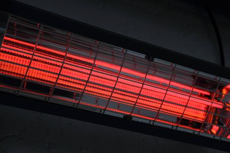 Photo pour A switched on infrared heater on a house wall - image libre de droit